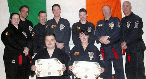 (L-R)  back: Freda Roberts, Ciaran Roberts, Alan Corrigan, Darryl Murray, Jonathan Tully, Barney Coleman, Dermot O'Reilly front: John Bradley and Jessica O'Reilly who received their second dan black belts